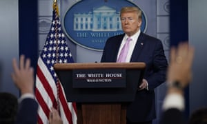 Donald Trump answers questions during a coronavirus task force briefing at the White House in Washington Friday.