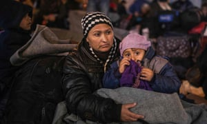 Refugees wait for a train to Serbia on the Greek-Macedonian border on 25 February 2016