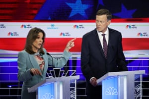 'Some might consider a safe choice is the most dangerous choice we can make': Williamson with John Hickenlooper at the first Democratic presidential debate, 27 June, Miami, Florida.
