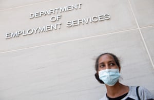 Diana Yitbarek, 44, of Washington DC, stands outside the Department of Employment Services, after trying to find out about her unemployment benefits on 16 July.