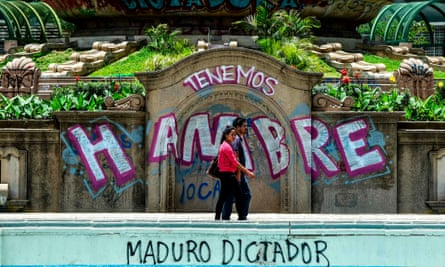 Graffiti in Caracas reads 'we are hungry'. The country's dire economic situation has caused shortages of food and medicine.