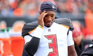 Jameis Winston walks to the sideline after his benching on Sunday
