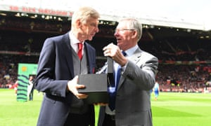 Sir Alex Ferguson presenting a special gift to the Arsenal manager, Arsène Wenger