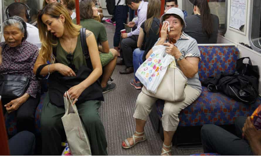 Hot travellers on the tube in London