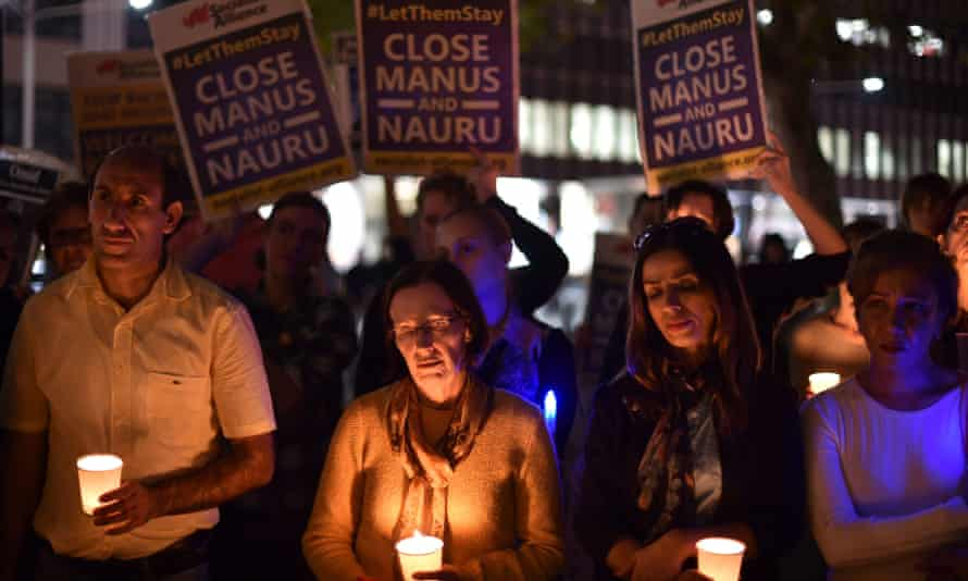 A vigil for an Iranian refugee who died after setting himself on fire on Nauru.