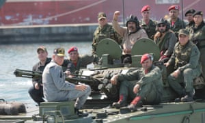 Venezuela's President Nicolas Maduro and his wife Cilia Flores are seen atop a military vehicle during a military exercise in Puerto Cabello.