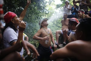 Juan Carlos Paso sprays water from his mouth on others during a ceremony. The cult of the goddess is hundreds of years old and draws on elements of the Afro-Caribbean religion Santeria and indigenous rituals, as well as Catholicism