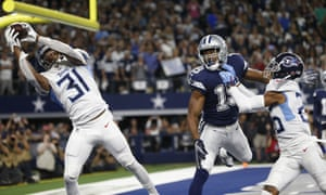 Kevin Byard intercepts a pass intended for Dallas Cowboys wide receiver Amari Cooper