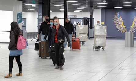 Passengers arriving at Luton airport in the UK off a commercial flight.