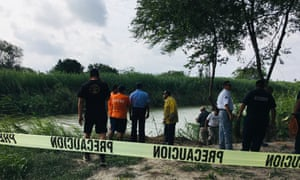 Authorities stand behind yellow warning tape along the Rio Grande bank where the bodies of Salvadoran migrant Oscar Alberto Martínez Ramírez and his daughter Valeria were found, in Matamoros, Mexico Monday.