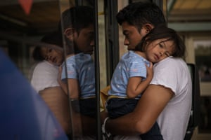 A Honduran migrant recently released from federal detention boards a bus in Texas with his two-year-old daughter.