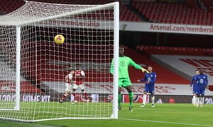 Chelsea goalkeeper Edouard Mendy watches as a cross from Bukayo Saka of Arsenal bounces off the crossbar and goes in.