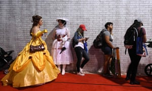 People queue outside a Disney fan club convention in California