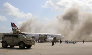 Dust rises after the explosions at Aden airport