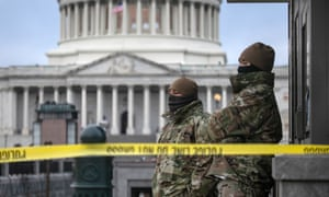 National Guard troops stand watch at the US Capitol on Friday in Washington DC.