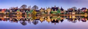 Houses line a river bank in Zaanse Schans, Netherlands