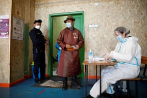 Ulaanbaatar, Mongolia. A man waits at a polling station during the presidential election