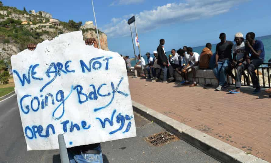 Migrants make their message clear in the Italian town of Ventimiglia on the border with France