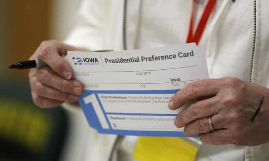 A volunteer holds a presidential preference card before the start of a Democratic caucus.