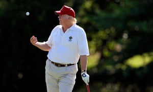 Donald Trump participates in a pro-am round of the AT&T National golf tournament at Congressional Country Club.