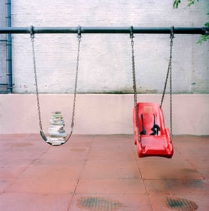 Stack of books on a swing, in a Harlem playground.