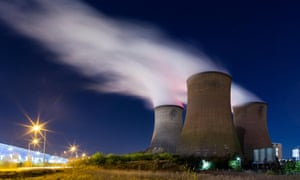 Rugeley power station cooling towers at night.