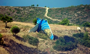The tail fin of the Boeing 737 – the most intact part of the plane – at the crash site near Athens