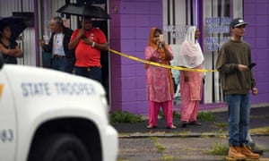 Local residents watch as officers investigate the apartment of Ahmad Khan Rahami in Elizbeth, New jersey, on September 19, 2016.