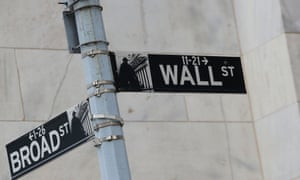 Street signs for Broad St. and Wall St. are seen outside of the New York Stock Exchange (NYSE).
