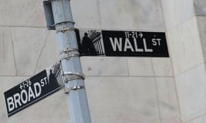 Street signs for Broad St. and Wall St. are seen outside of the New York Stock Exchange (NYSE) in New York.