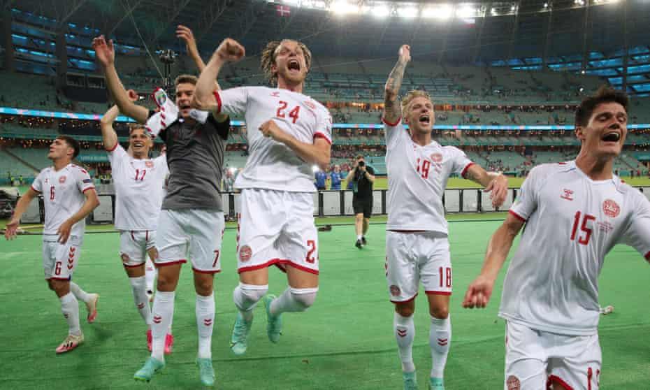 Brentford's Mathias Jensen  and Christian Norgaard with teammates enjoy Denmark's Euro 2020 quarter-final win over the Czech Republic.
