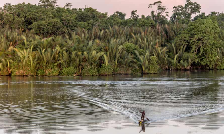 A man paddles a canoe on the Sepik River in Papua New Guinea