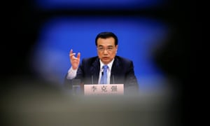 China's Premier Li Keqiang gestures during a news conference after the closing ceremony of China's National People's Congress.