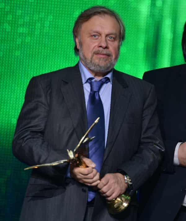 Producer Leonid Lebedev with an award for Geographer Drunk Away His Globe at the 27th Nika awards ceremony in 2014