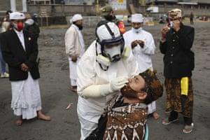 A Hindu devotee has a coronavirus test before he takes part in the Yadnya Kasada festival in Probolinggo, Indonesia