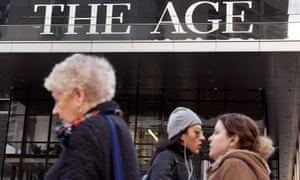 People walk past the offices of the Age newspaper in Melbourne