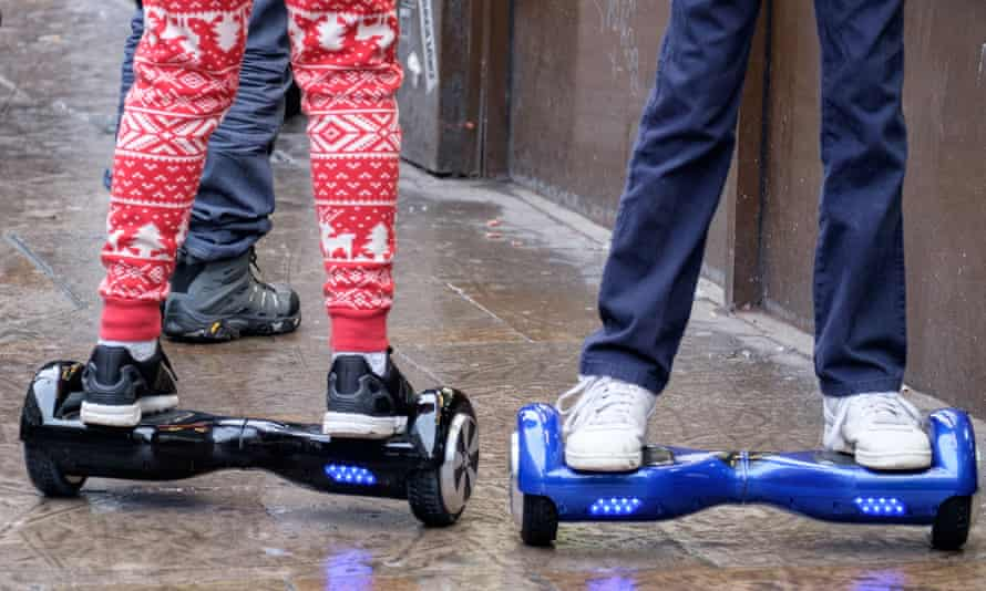 Teenagers using hoverboards in London, Britain.