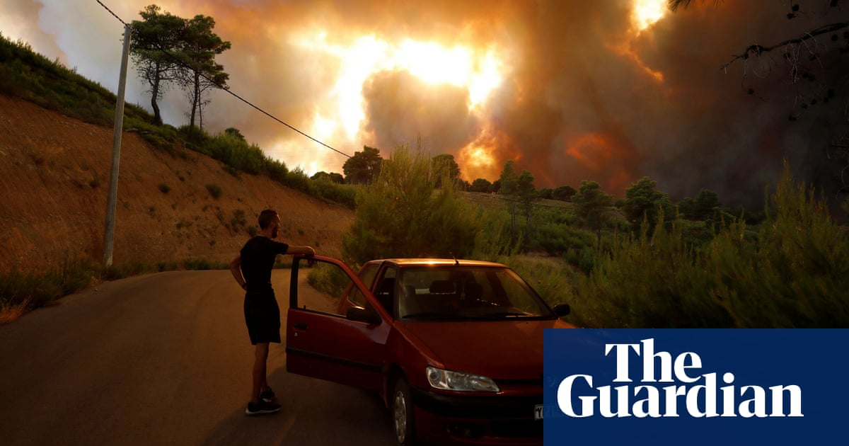 Greek prime minister says 'worst is yet to come' as wildfires rage around Athens – video