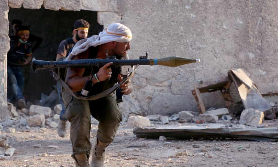 Members of the Jaish al-Fatah coalition clash with Assad regime soldiers in Ramouseh on Saturday.