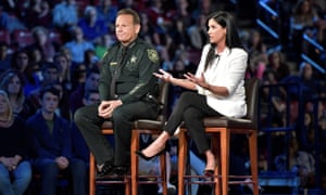 National Rifle Association spokesperson Dana Loesch answers a question while sitting next to Broward Sheriff Scott Israel during a CNN town hall meeting.