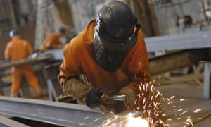 A welder in a factory in Derbyshire