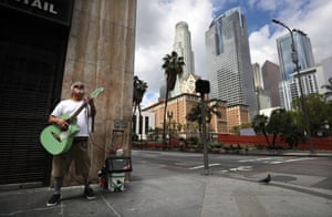 Los Angeles, US: blind busker Ramon Ponce plays guitar