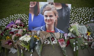 floral tributes for Jo Cox, in Parliament Square, outside the House of Parliament in London,
