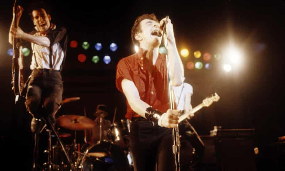 (L-R) Mick Jones and Joe Strummer of the Clash performing at Warfield Theater in California, 2 March 1980.