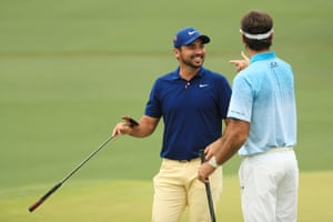 Jason Day of Australia, pictured joking with Bubba Watson of the United States. He's in the mix at -9.