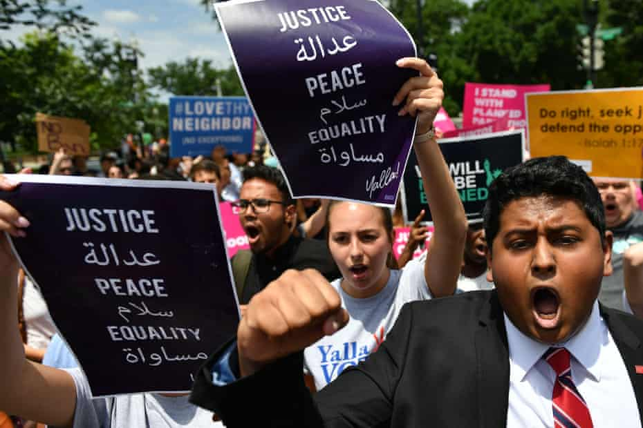 People protest Donald Trump's travel ban outside of the US supreme court in Washington DC on 26 June 2018.