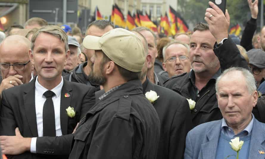 AfD leader Björn Höcke, left, with Pegida founder Lutz Bachmann, second from right, in a commemoration march in Chemnitz in September.