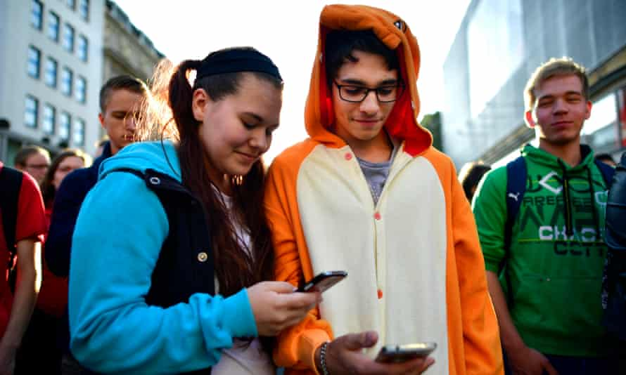 Young people in Hanover, Germany, playing Pokémon Go. At least 20 million people around the world are trying to play the game.