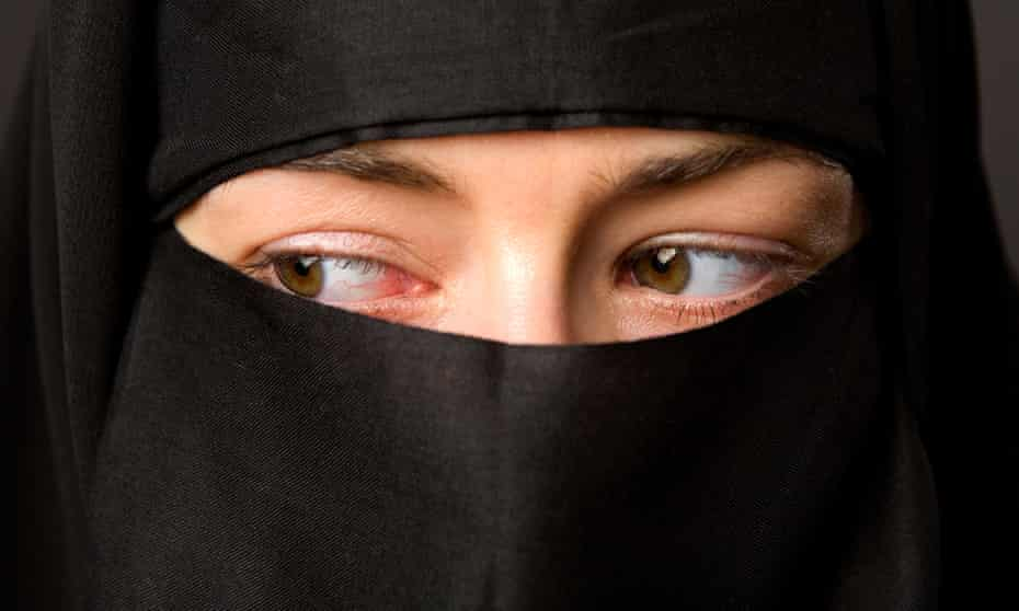 A woman in a black veil.