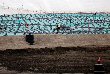 Rows of black bags at a soil storage facility in Fukushima